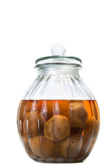 Vietnamese salted and pickled limes in a glass jar