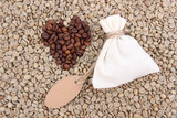 Sack with coffee on green coffee beans background