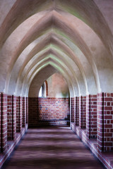 Interior old empty hall. Arch of castle. Medieval architecture.