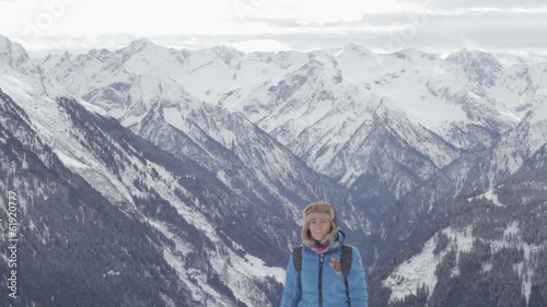 Woman in the mountains looking at beautiful view, Alps, Austria