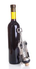 Corkscrew with bottle of wine isolated on white