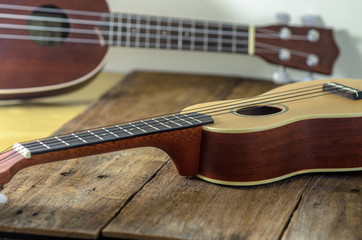 ukuleles  against a wooden background.