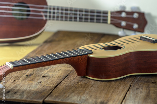 ukuleles  against a wooden background.