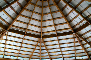 looking up at exposed beam roof