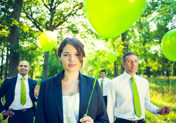 Group of Green Business People Holding Balloons