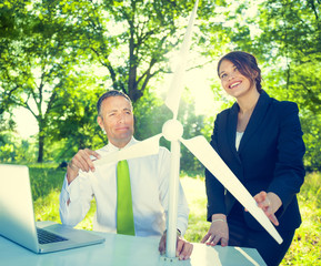 Business People Holding Wind Turbine