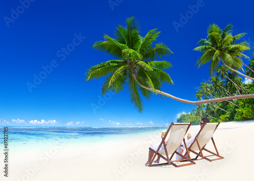 canvas print picture Couple Relaxing on the Beach