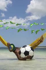 Brazilian Relaxing with Soccer Football in Beach Hammock