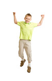 Handsome kid boy jumping or dancing on white background