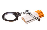 Cigarettes and handcuffs isolated. Addition