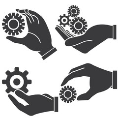 hand holding gears, management concept