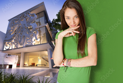 Young woman by elegant building