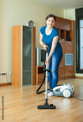 Woman  with vacuum cleaner  at home