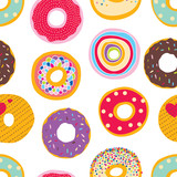 Cute donuts. Vector a seamless pattern.