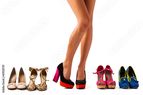 canvas print picture Beautiful women legs with different pairs of shoes