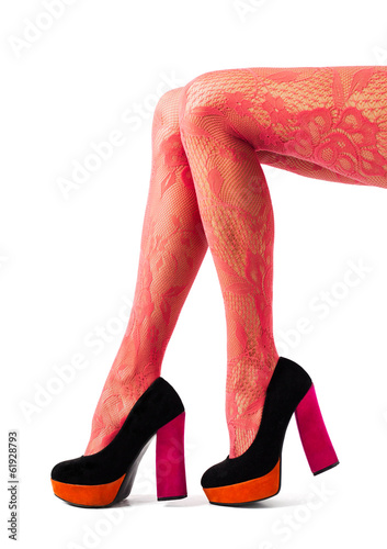 Beautiful women legs with red tights and high heel shoes