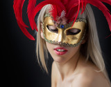 Fashion photo of beautiful woman in mask