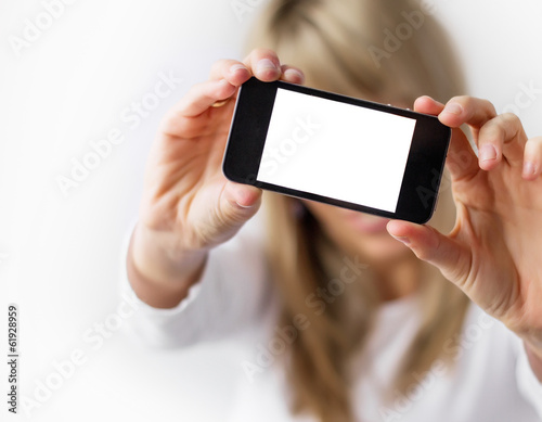 Woman taking self portrait with her mobile phone