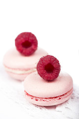 Macaroons with raspberry on white background