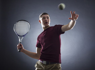 tennis player prepared for backhand stroke