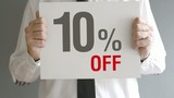 Salesman holding sale tag with ten percent sales discount price