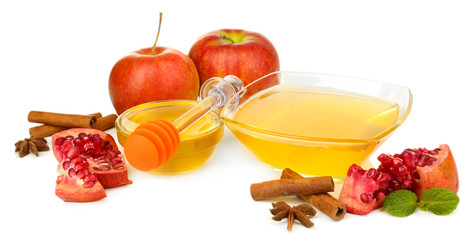 Sweet honey with pomegranate, apples and cinnamon isolated