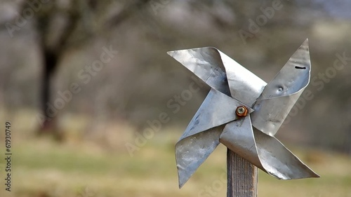 Homemade pinwheel of sheet metal is ugly and dysfunctional