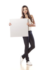 young pretty girl hold a blank board