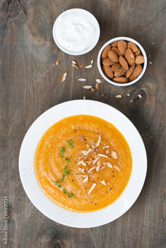 carrot soup with almonds and yogurt, top view