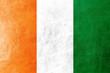 Ivory Coast Flag painted on leather texture