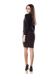 rear view of young business woman on white background