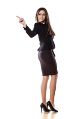 business woman pointing with her finger on empty space