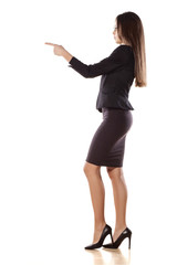 young business woman pointing with her finger on empty space