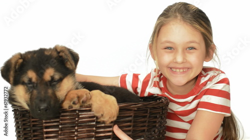 cheerful child and a puppy in a wicker basket