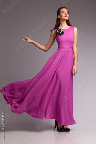 Girl in magenta dress. Portrait. Studio. Fashion