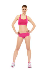 Frau in Fitnessoutfit pink