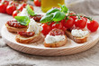 Italian traditional crostini with mozzarella and dried tomato