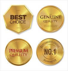 Gold metal badges on white