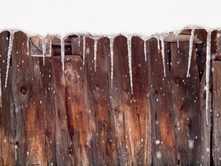 icicles on a wooden hut