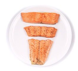 Slices of red fish fillet on plate.