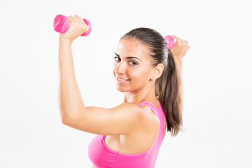 Beautiful woman exercising with dumbbells.