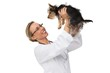 Vet lifting up yorkshire terrier and smiling