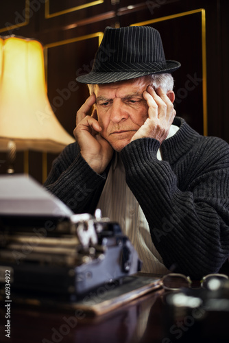 Worried Retro Senior Man writer