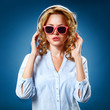 woman wearing headphones and sunglasses