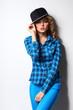 woman wearing cap standing near wall