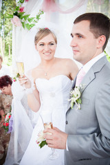 Portrait of newly married couple holding glasses of champagne