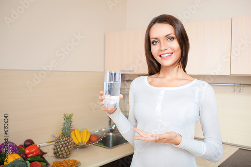 woman holding glass with fresh water