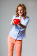 happy woman holding heart symbol