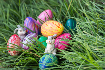Easter bunnies and eggs on the green grass