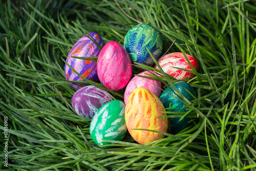Easter eggs on the green grass background